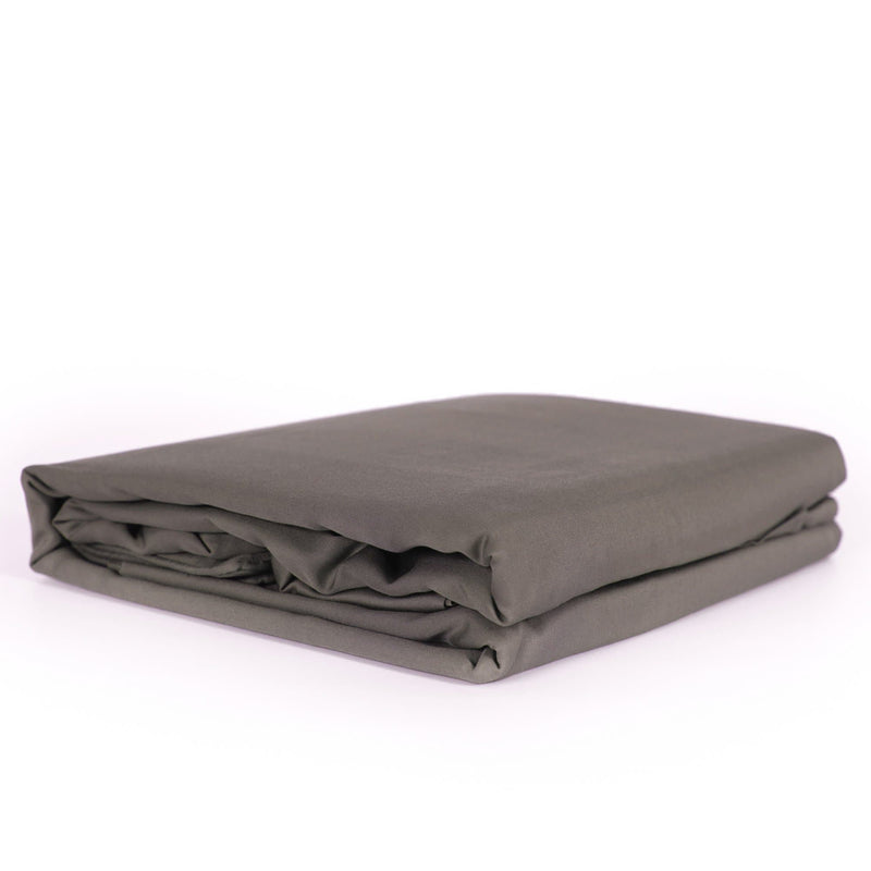 beautiful soft charcoal grey quilt cover set folded on a white background