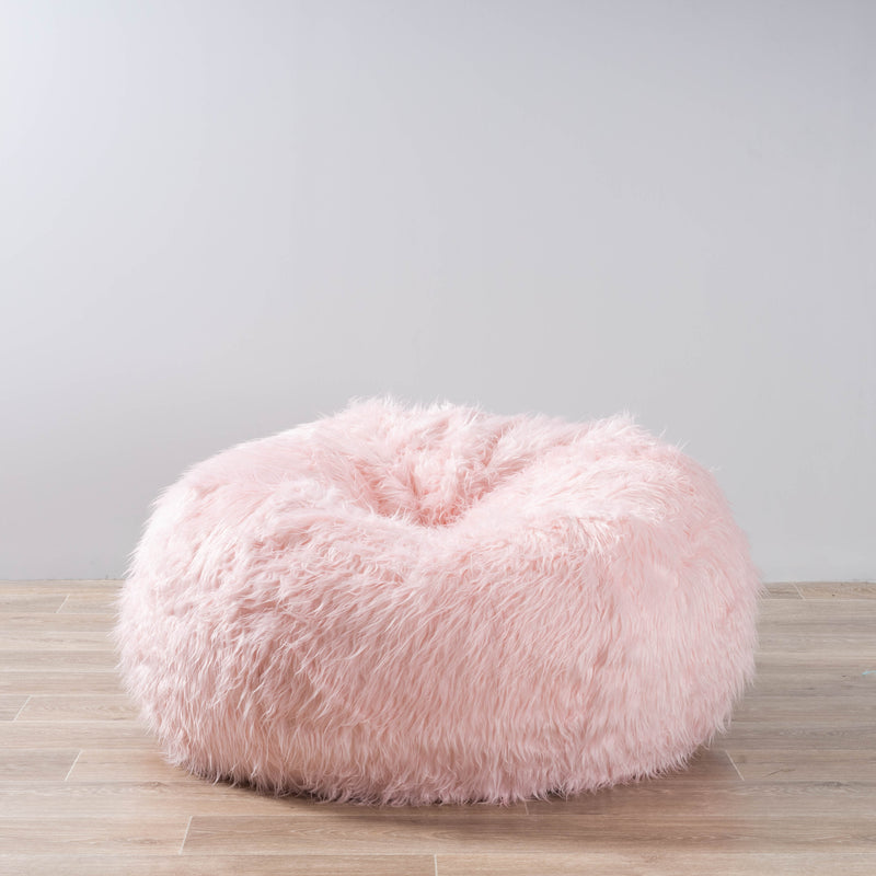 soft fluffy pink beanbag on a wooden floor with a white background