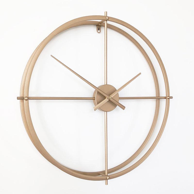 modern gold metal wall clock on a white background