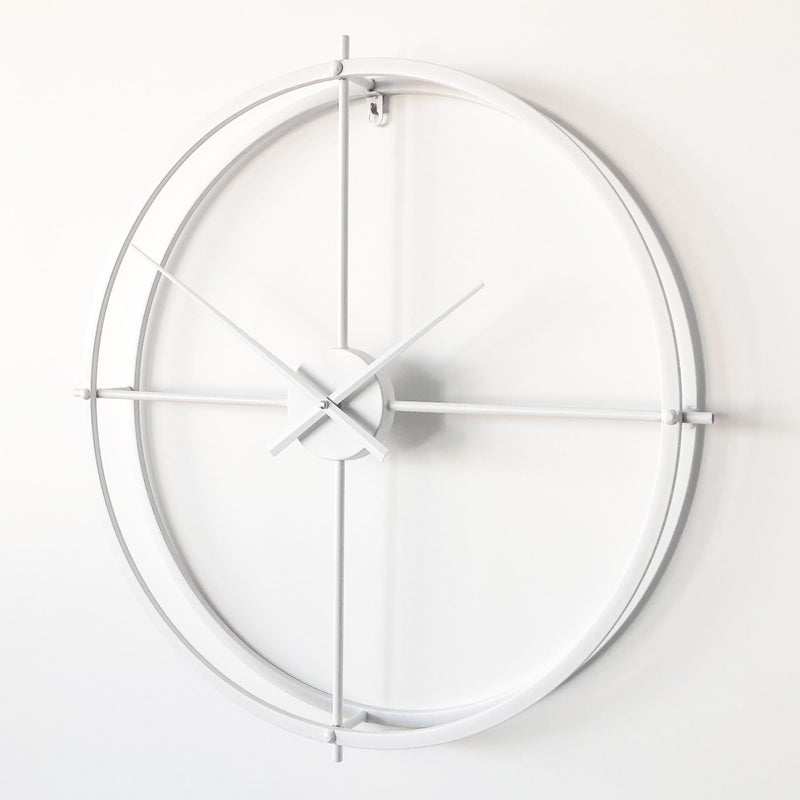 modern white metal wall clock on a white background