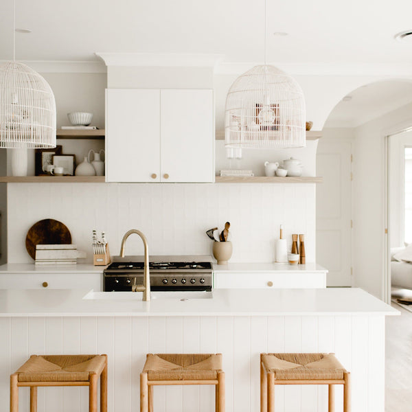 siena pendant light in modern white kitchen with rattan bar stools