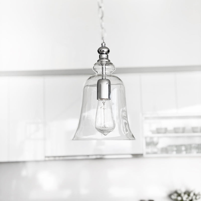 gracie chrome bell shape glass pendant light hanging over a kitchen bench