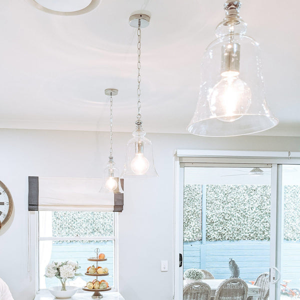 chrome pendant light hanging in a luxe hamptons kitchen