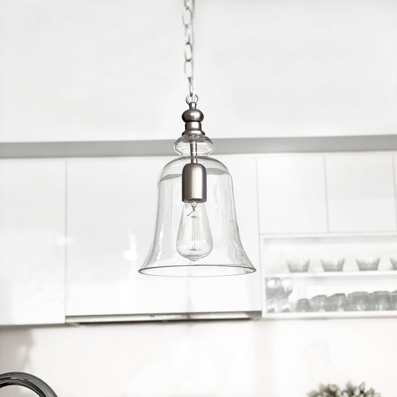 matt silver glass bell shape pendant light hanging over a kitchen bench
