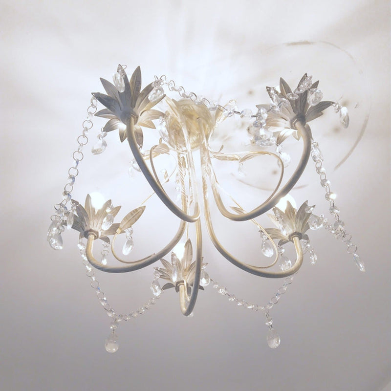 shabby chic chandelier with leaf design installed