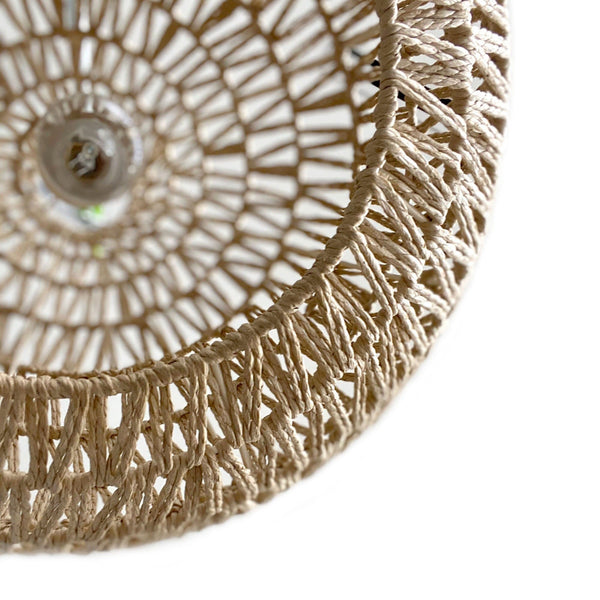 closeup of natural rope pendant light on a white background
