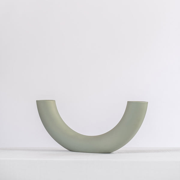 modern sage ceramic vase on a white shelf