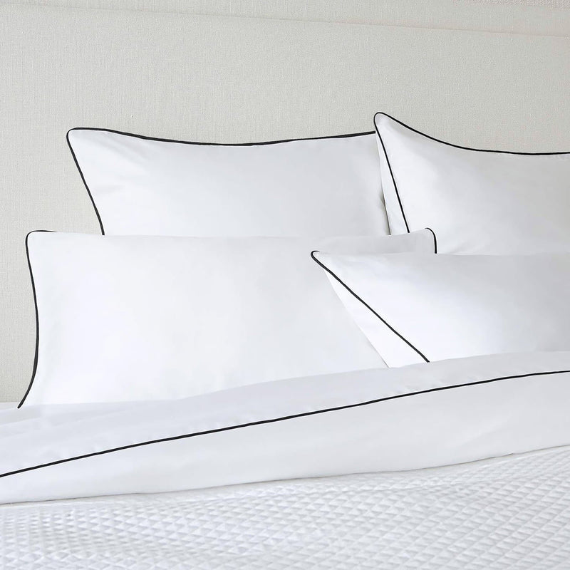 white quilt cover and pillowcase set with black piping