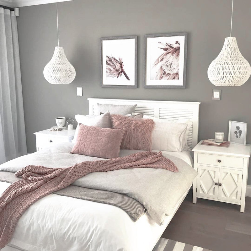 white rope pendant light hanging as bedside lamps