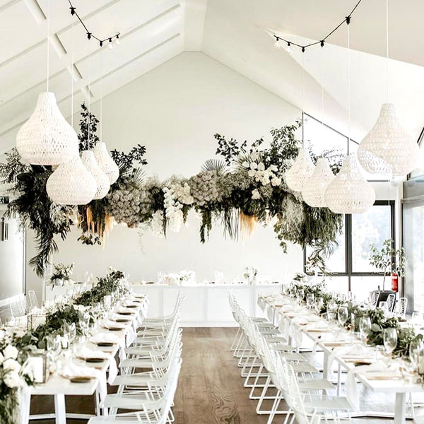white byron rope pendant lights in a wedding reception space