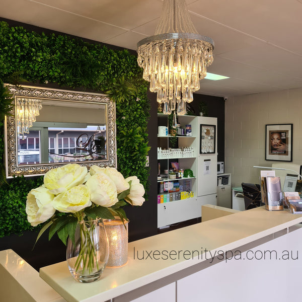 empire chandelier with glass crystals hanging in a beauty spa
