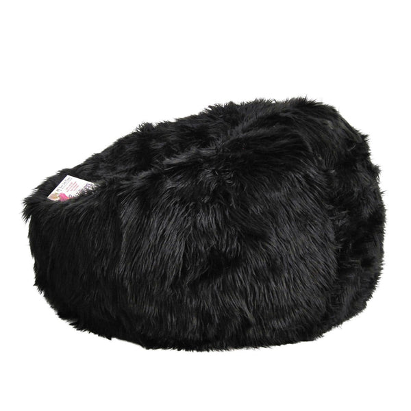 black lush fur beanbag with a book on a white background