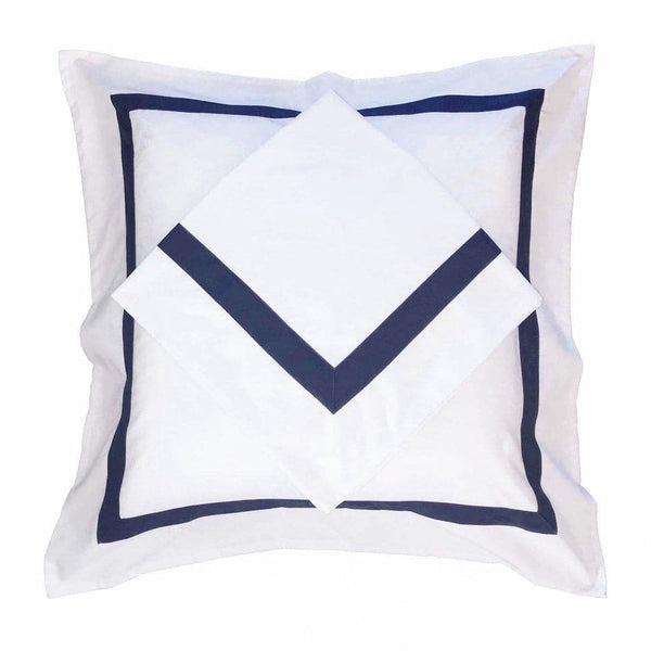set of white European pillowcases with navy trim