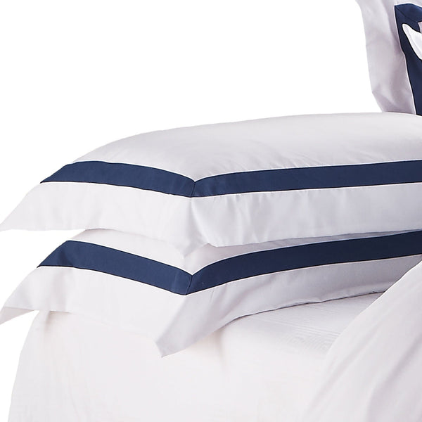set of white pillowcases with navy trim