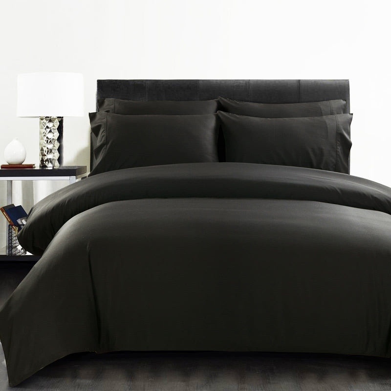black bamboo quilt cover on a black bed with bedside table and lamp