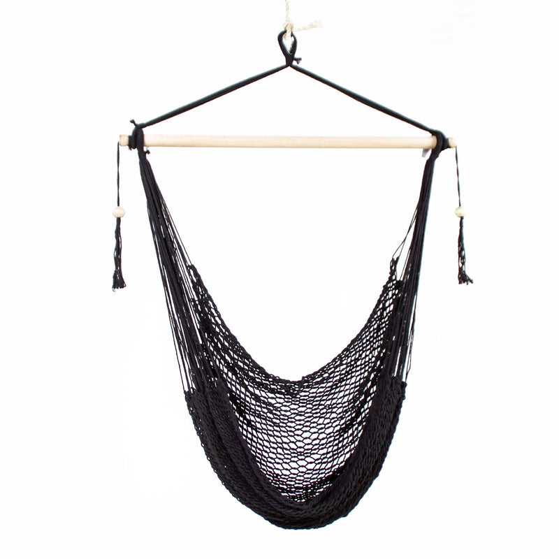 black macrame rope hammock swing with wooden beads on a white background