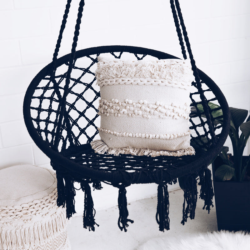 black macrame hammock swing chair with white cushion