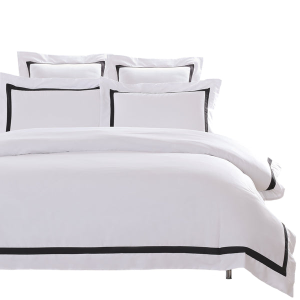 white quilt cover with black trim white on white