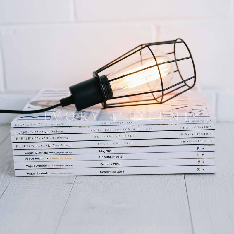 black-industrial-wire-pendant-light-bulb-on