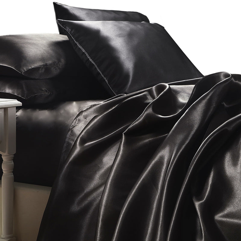 satin sheet set in black with pillows