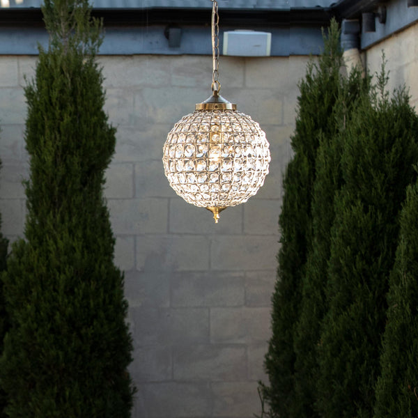 casablanca Italian inspired crystal ball chandelier with antique brass fittings in hamptons garden