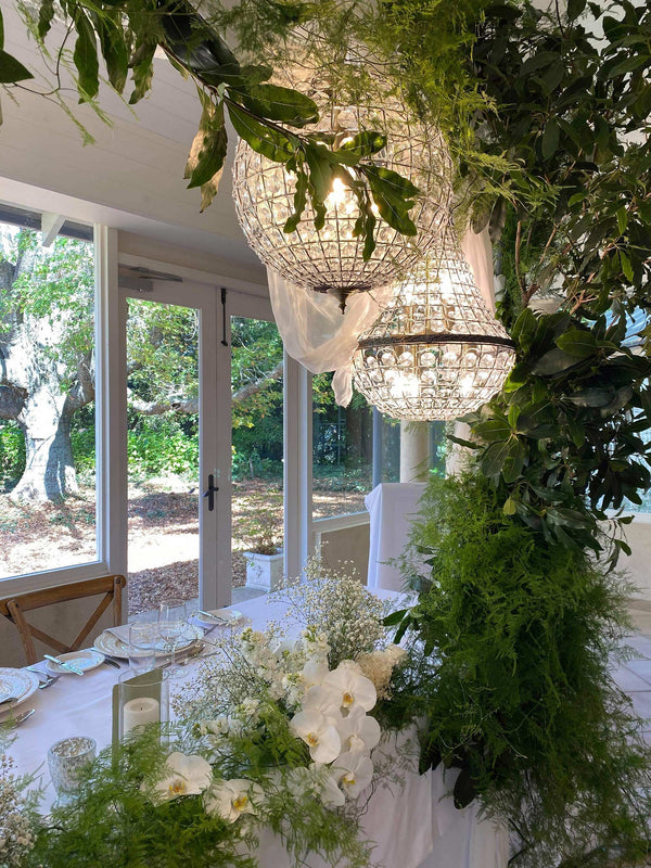 casablanca Italian inspired crystal ball chandelier with antique brass fittings in wedding setting