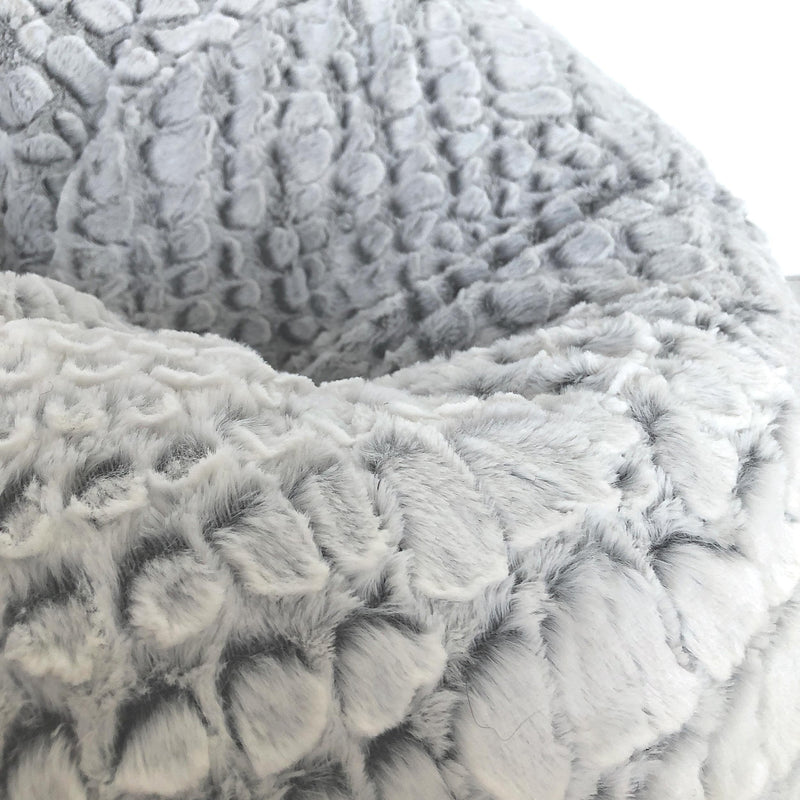 close up of a soft silver white cashmere fur beanbag on white background
