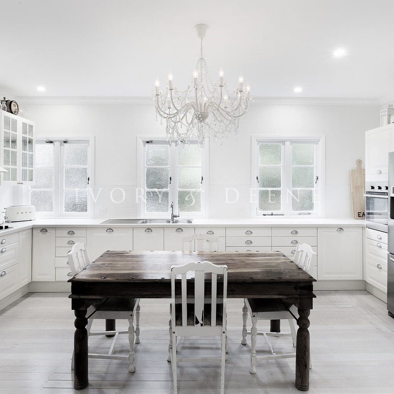 large chandelier in white kitchen