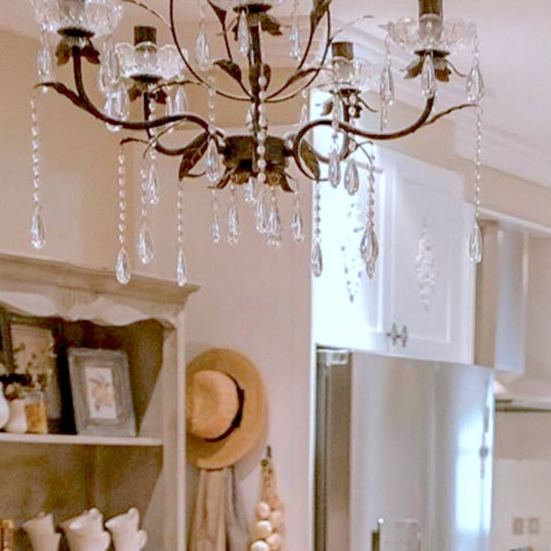 shabby chic Celine chandelier with glass crystals hanging in a living room