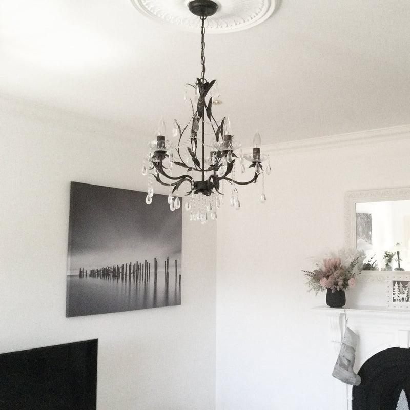 celine distressed gold shabby chic chandelier hanging in a lounge room