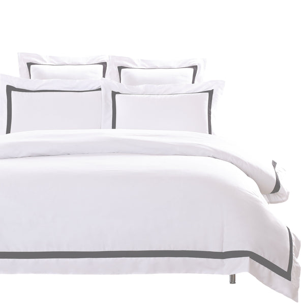 charcoal grey trim bedding white quilt on white background