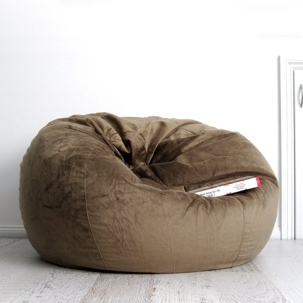 coffee coloured fur beanbag on wooden floor with white background