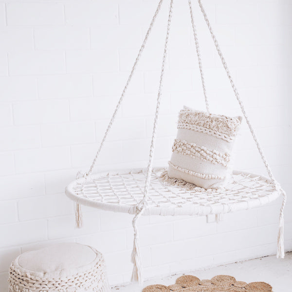 cream nest swing hammock with pillow on top