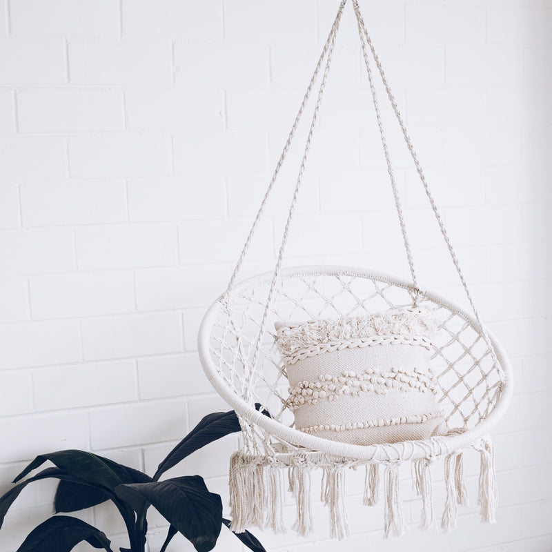 brazilian hammock chair swing in white room with a pot plant