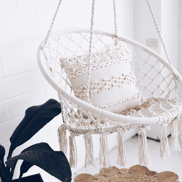 brazilian hammock chair swing in white room with green plant