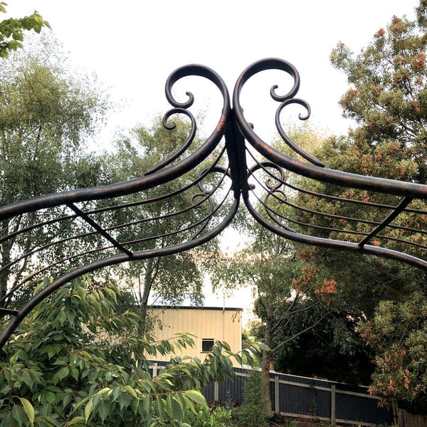 distressed black french provincial garden arch