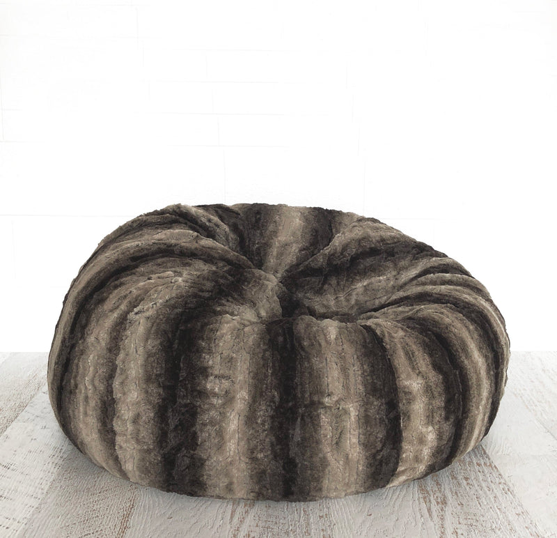 black brown and tan fur beanbag from ivory and deene on white wall with wooden floor