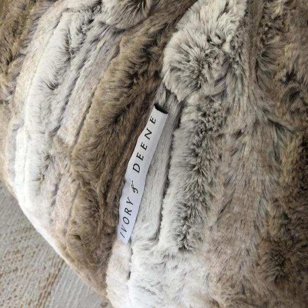 close up of a tan and latte and white faux fur bean bag
