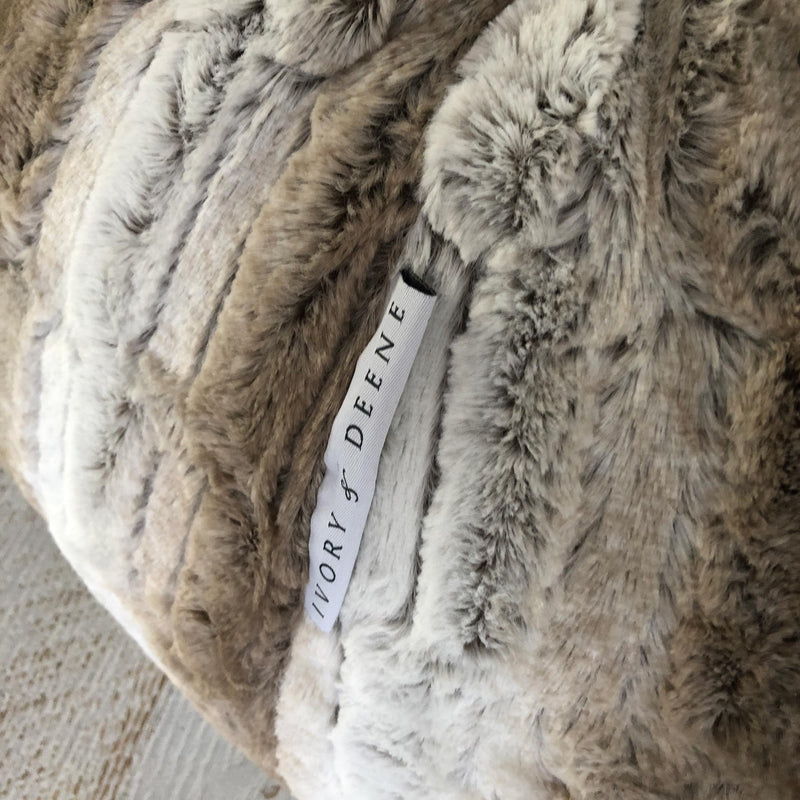 77a82fbc44 close up of a tan and latte and white faux fur bean bag