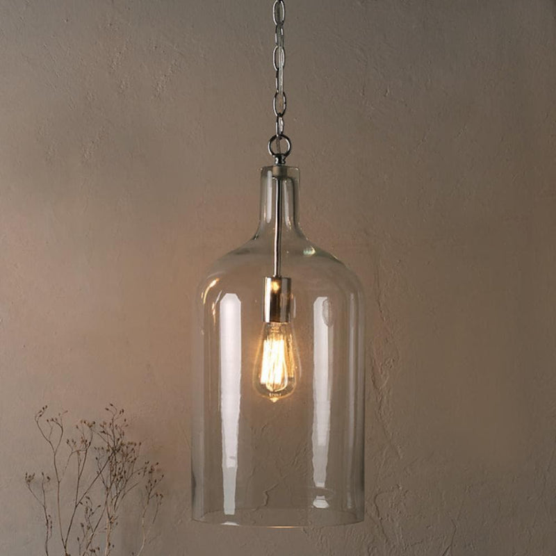 glass jug pendant light with vintage edison globe turned on