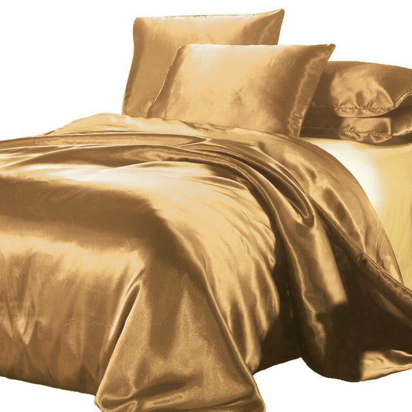 satin quilt cover gold with pillows on white background