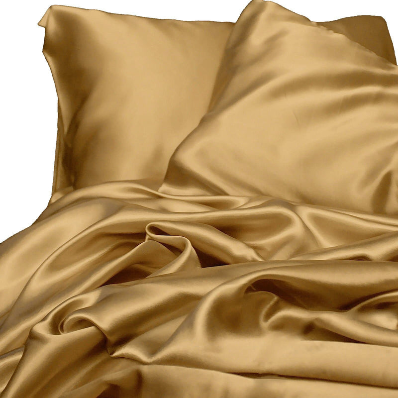 satin sheet set gold on white background Ivory & Deene