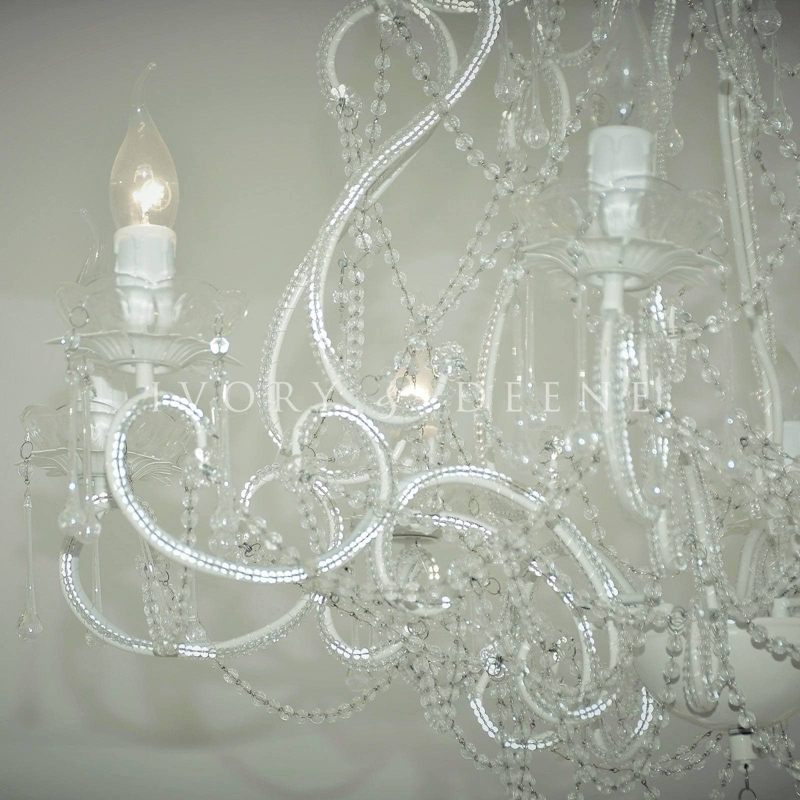 close up photo of a large french provincial cream chandelier