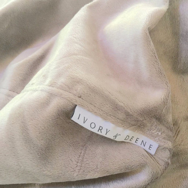 close up of champagne latte fur beanbag with ivory and deene label
