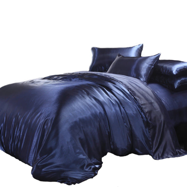satin quilt cover navy blue with pillows on a white background