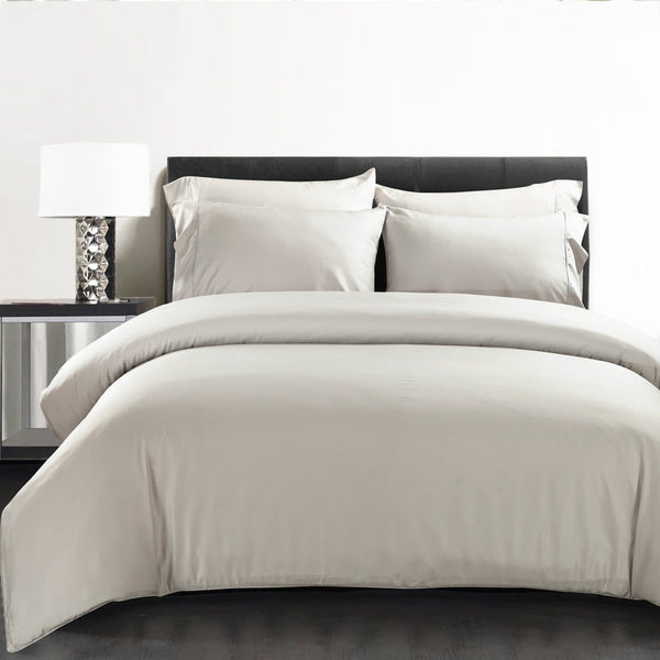 silver bamboo quilt cover on black bed with pillows