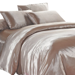 satin quilt cover champagne latte with pillows on a white background