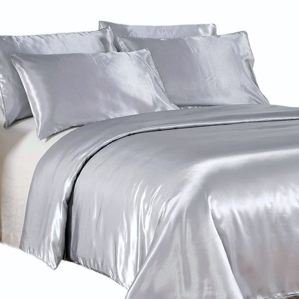 satin quilt cover silver with pillows on a white background