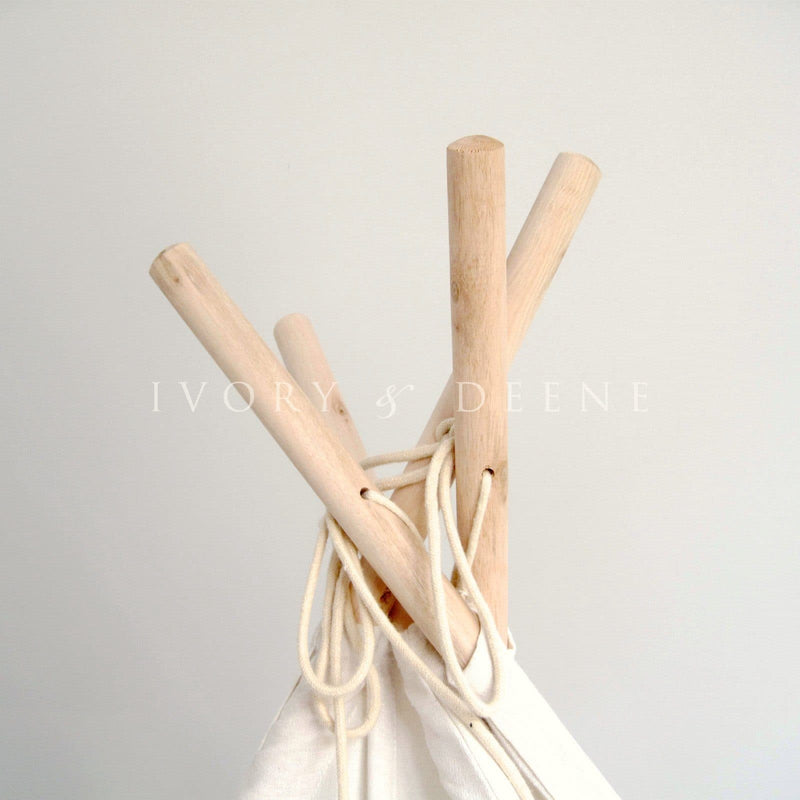 teepee tent wooden rods with rope ties