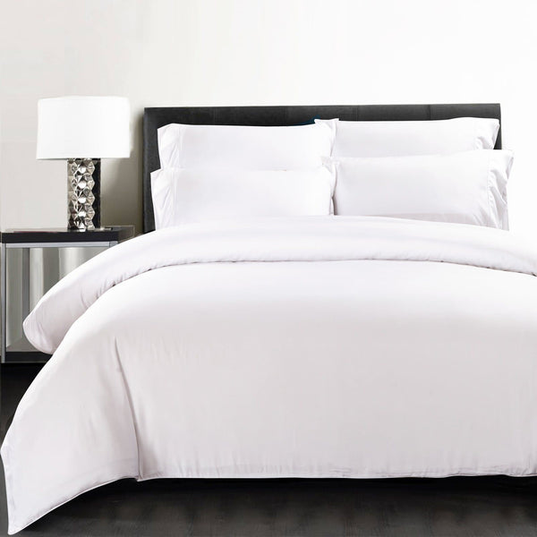 bamboo quilt cover in white on black bed